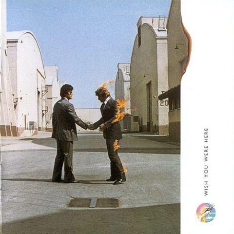 """""""Wish You Were Here"""", nono album in studio dei Pink Floyd (EMI, 1975). La copertina è stata realizzata da Storm Thorgerson"""